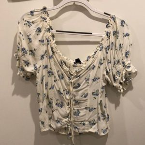 White Blouse with Blue Flowers